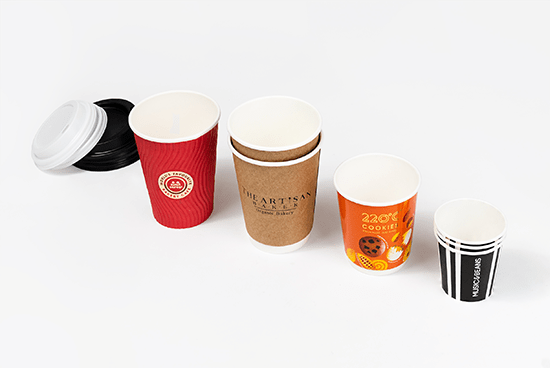 A selection of paper artisan cups in various sizes. Featuring lids.