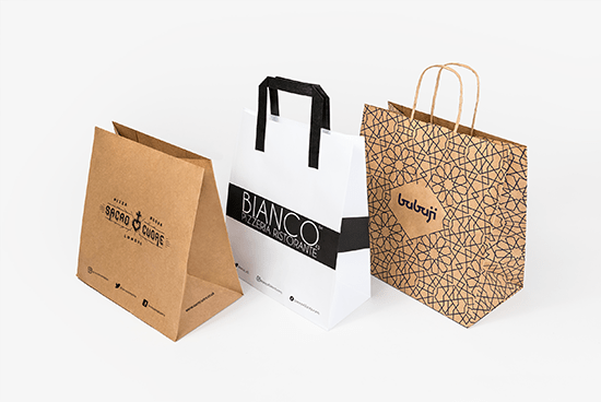 A selection of paper carrier bags, for pizzerias. These options feature different styles of handles.