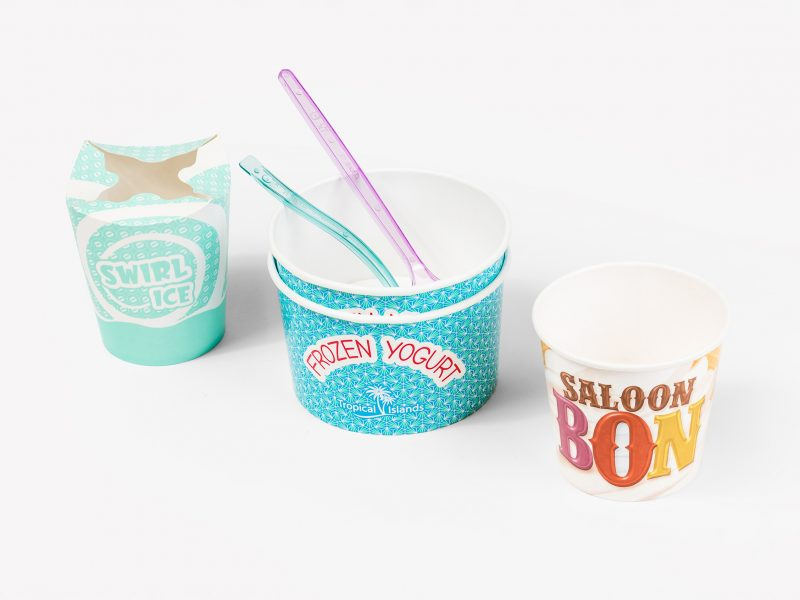 A selection of ice cream pots, examples shown are of varying styles and sizes. Spoons are also shown.