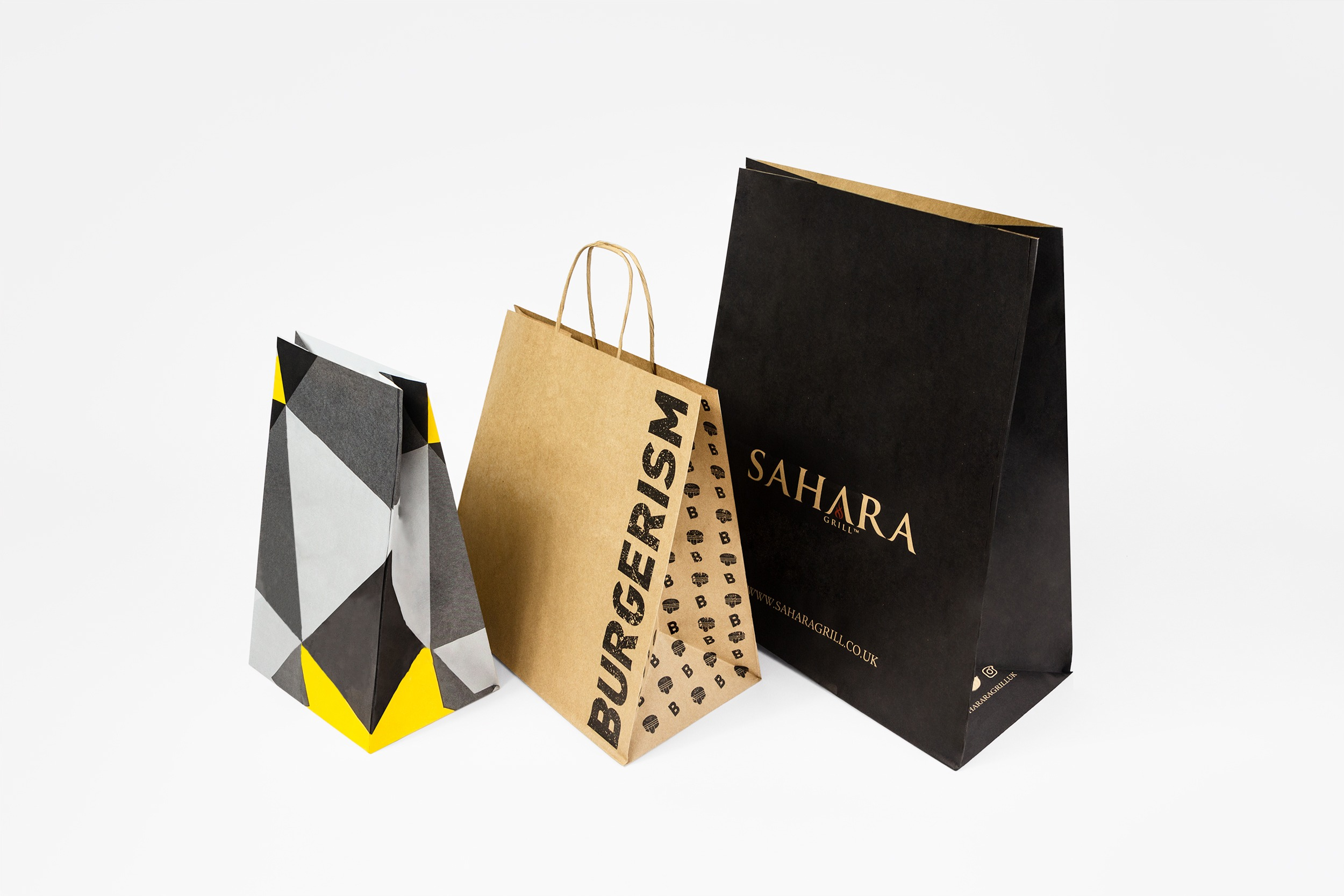 A selection of carrier bags in a range of sizes. Both with and without handles.